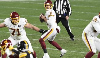 Washington Football Team quarterback Alex Smith (11) looks to pass during the second half of an NFL football game against the Pittsburgh Steelers in Pittsburgh, Monday, Dec. 7, 2020. (AP Photo/Barry Reeger)