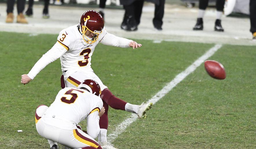 Washington Football Team kicker Dustin Hopkins (3) kicks a 45-yard field goal during the second half of an NFL football game in Pittsburgh, Monday, Dec. 7, 2020. Washington won 23-17. (AP Photo/Barry Reeger) **FILE**