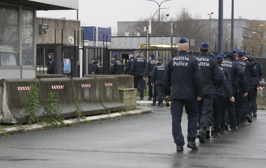 Police enter the site where the pre-trial chamber for the attacks at Zaventem airport and Brussels will take place, in Brussels, Thursday, Dec. 3, 2020. The new courtroom is housed in the former NATO headquarters. One of the first cases to be staged at the new site will be the case against defendants suspected of involvement in the Brussels attacks at Brussels Airport and Maalbeek metro station on 22 March 2016. (AP Photo/Sylvain Plazy)