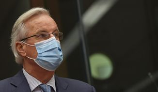 EU chief negotiator Michel Barnier wears a protective face mask as he arrives to brief EU ambassadors regarding Brexit negotiations at the European Council building in Brussels, Monday Dec. 7, 2020. European Union chief negotiator Michel Barnier on Monday set off one of the most intense days in the long-running Brexit trade negotiations with a pre-dawn debriefing of the 27 member states to see if a deal is still possible with London ahead of the Jan. 1 deadline. (John Thys, Pool via AP)