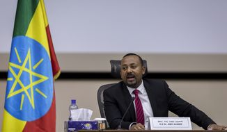 "Ethiopia's Prime Minister Abiy Ahmed responds to questions from members of parliament at the prime minister's office in the capital Addis Ababa, Ethiopia Monday, Nov. 30, 2020. The fugitive leader of Ethiopia's defiant Tigray region on Monday called on Prime Minister Abiy Ahmed to withdraw troops from the region as he asserted that fighting continues ""on every front"" two days after Abiy declared victory. (AP Photo/Mulugeta Ayene)"