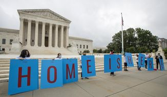 FILE - In this June 18, 2020, file photo, Deferred Action for Childhood Arrivals (DACA) students gather in front of the Supreme Court in Washington. The Trump administration has fully restored the Obama-era Deferred Action for Childhood Arrivals program for immigrants brought to the U.S. as youth, complying with a federal judge's order. The announcement is a major, if temporary, victory for people who have been unable to apply since Trump ended DACA in September 2017. (AP Photo/Manuel Balce Ceneta, File)