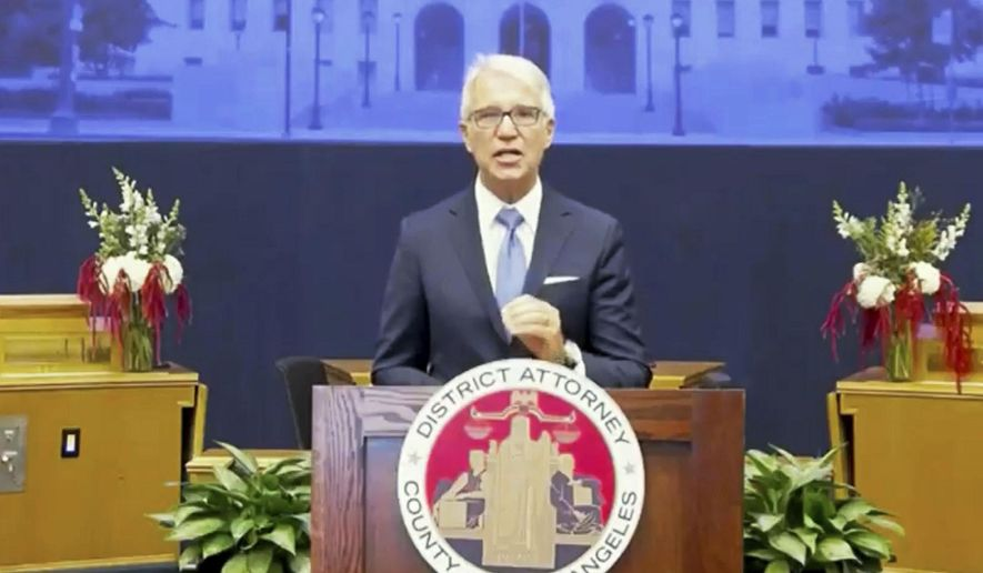 In this photo from the County of Los Angeles streaming video, incoming Los Angeles County District Attorney George Gascon speaks after he was sworn in in downtown Los Angeles Monday, Dec. 7, 2020. Gascon, who co-authored a 2014 ballot measure to reduce some nonviolent felonies to misdemeanors, has promised more reforms to keep low-level offenders, drug users, and those who are mentally ill out of jail and has said he won't seek the death penalty. (County of Los Angeles via AP)