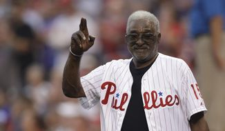 FILE - Former Philadelphia Phillies' Dick Allen waves to the crowd before a baseball game against the New York Mets in Philadelphia, in this Saturday, Aug. 12, 2017, file photo. Dick Allen, a fearsome hitter who was a seven-time All-Star, the 1964 NL Rookie of the Year and the 1972 AL MVP, has died. He was 78. The Philadelphia Phillies, the team Allen started out with, announced his death on Monday, Dec. 7, 2020. (AP Photo/Matt Slocum, File)