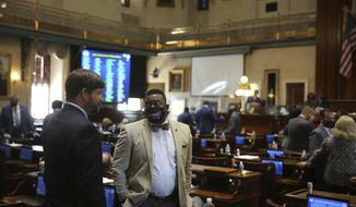 State Rep. Ivory Thigpen, D-Columbia, speaks to a fellow South Carolina House member on Wednesday, Dec. 2, 2020, in Columbia, S.C. The House ended its two day organizational session on Wednesday. (AP Photo/Jeffrey Collins)