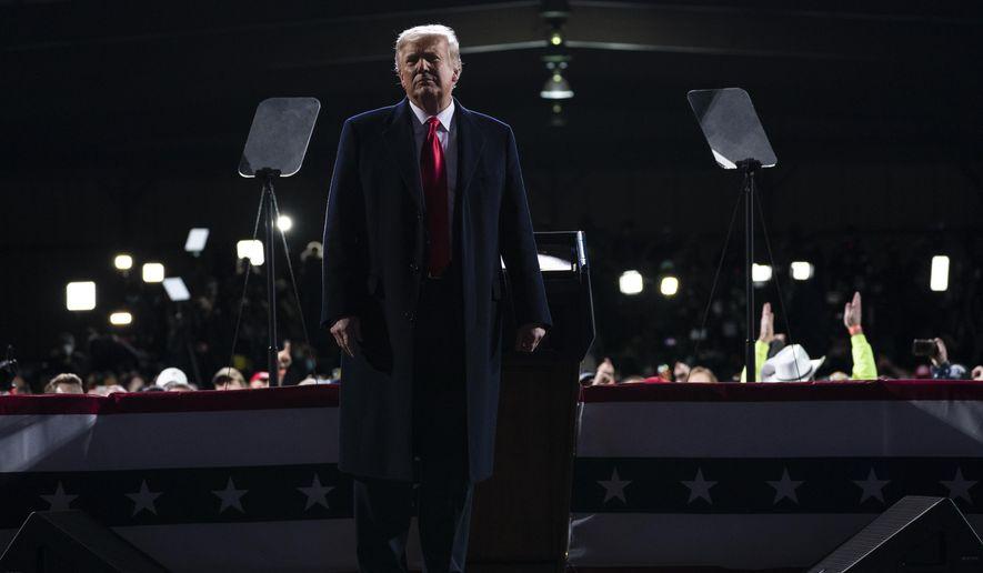 President Donald Trump speaks during a campaign rally for Senate Republican candidates, Sen. Kelly Loeffler, R-Ga., and Sen. David Perdue, R-Ga., at Valdosta Regional Airport, Saturday, Dec. 5, 2020, in Valdosta, Ga. (AP Photo/Evan Vucci)