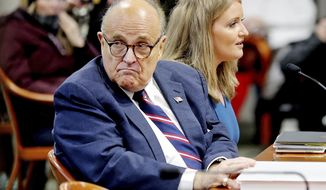 Rudy Giuliani, President Donald Trump's personal attorney, scans the room during a Michigan House Oversight Committee hearing for suspicion of voter fraud within the state at the House Office Building in Lansing, Mich., on Wednesday, Dec. 2, 2020. (Mike Mulholland/The Grand Rapids Press via AP)
