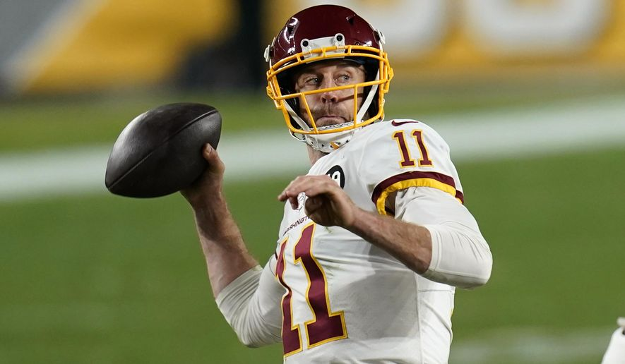 Washington Football Team quarterback Alex Smith (11) throws a 15-yard touchdown pass to Logan Thomas during the second half of an NFL football game against the Pittsburgh Steelers, Monday, Dec. 7, 2020, in Pittsburgh. (AP Photo/Keith Srakocic)