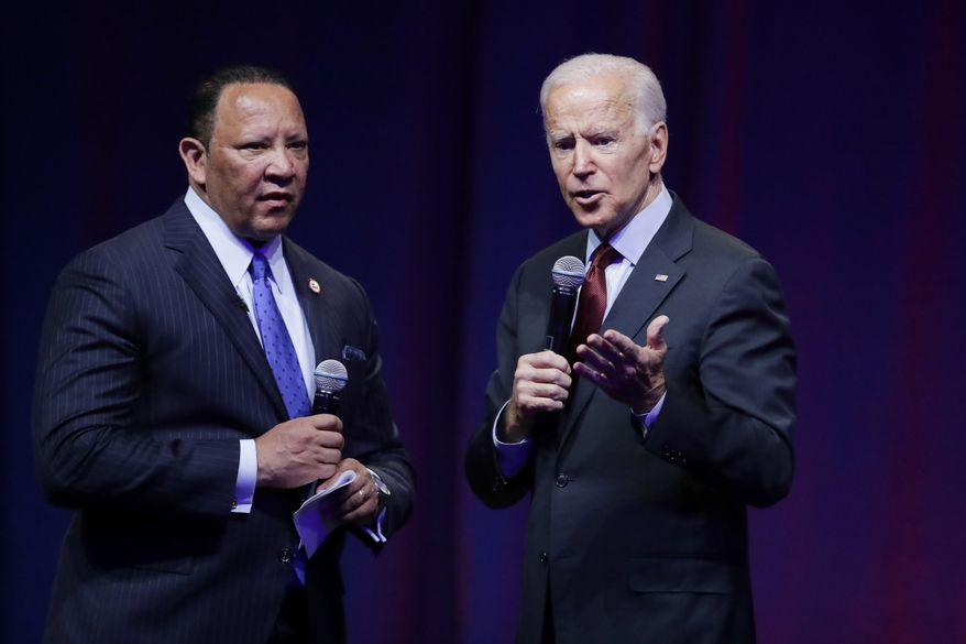 Democratic presidential candidate and former Vice President Joe Biden, right, gestures while speaking as Marc Morial, president of the National Urban League, listens during the National Urban League Conference, Thursday, July 25, 2019, in Indianapolis. (AP Photo/Darron Cummings) **FILE**
