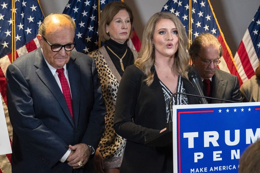 Members of President Donald Trump's legal team, including former Mayor of New York Rudy Giuliani, left, Sidney Powell, and Jenna Ellis, speaking, attend a news conference at the Republican National Committee headquarters, Thursday Nov. 19, 2020, in Washington. (AP Photo/Jacquelyn Martin) **FILE**