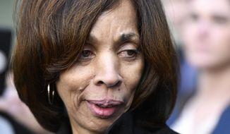 Former Baltimore Mayor Catherine Pugh leaves her sentencing hearing at U.S. District Court in Baltimore. (AP Photo/Steve Ruark, File)