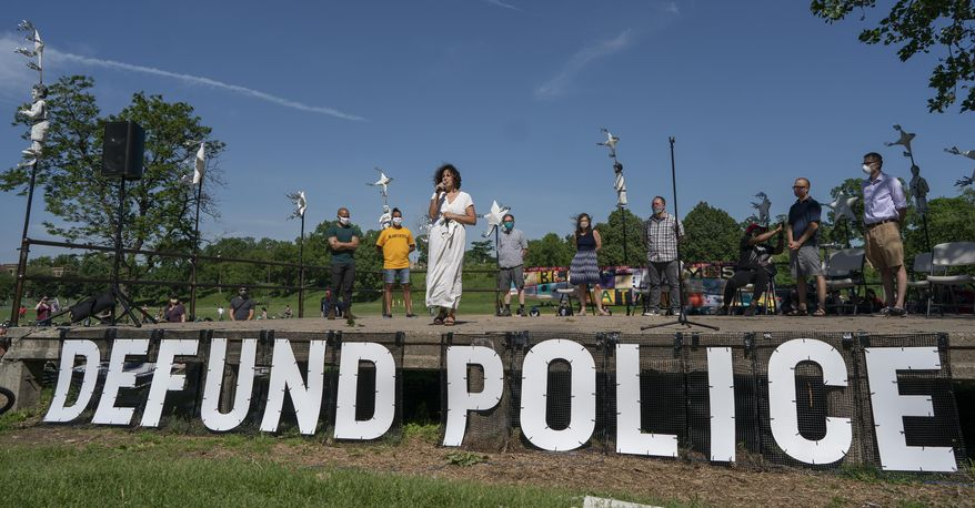 """FILE - In this June 7, 2020, file photo, Alondra Cano, a City Council member, speaks during """"The Path Forward"""" meeting at Powderhorn Park on Sunday, June 7, 2020, in Minneapolis. On Wednesday, Dec. 8, 2020, the Minneapolis City Council will decide whether to shrink the city's police department while violent crime is already soaring and redirect funding toward alternatives for reducing violence. (Jerry Holt/Star Tribune via AP, File)"""