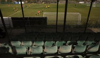 Beitar Jerusalem FC soccer team practices in Jerusalem, Tuesday, Dec. 8, 2020, a day after the club announced that Emirati Sheikh Hamad bin Khalifa Al Nahyan, a member of the Abu Dhabi ruling family, has purchased a 50% stake in the team. (AP Photo/Maya Alleruzzo)
