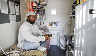 File-In this Feb. 13, 2020, file photo, Myon Burrell sits inside his cell at the Minnesota Correctional Facility in Stillwater. A national panel of legal experts recommended the immediate release of Burrell, who was sentenced to life in prison as a teenager nearly two decades ago. (AP Photo/John Minchillo, File)