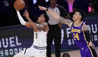 Denver Nuggets' Monte Morris (11) drives ahead of Los Angeles Lakers' Danny Green (14) during the second half of an NBA conference final playoff basketball game Saturday, Sept. 26, 2020, in Lake Buena Vista, Fla. (AP Photo/Mark J. Terrill)