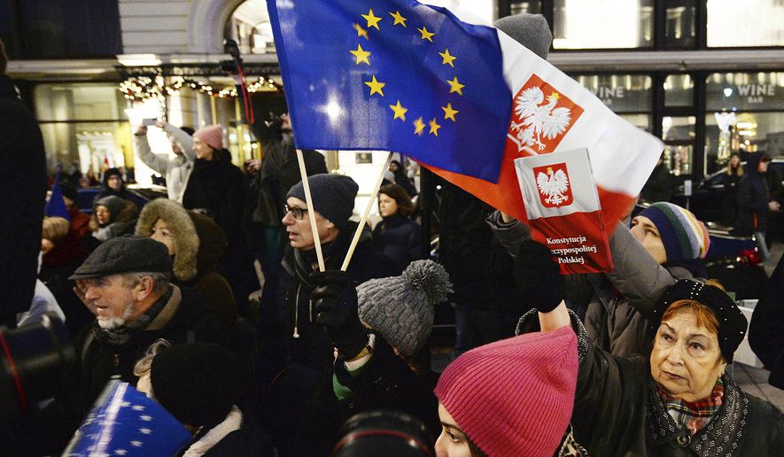 "In this  Jan. 11, 2020, file photo, protesters carry an EU flag at an anti-government protest in Warsaw, Poland. Some Poles are afraid that a drawn-out conflict with the EU over the next budget and values could put them on a path toward an eventual departure from the bloc, or ""Polexit."" Poland's conservative government denies that it has ever wanted to leave the 27-member bloc and popular support for EU membership runs very high. But critics fear the combative tone of some Polish leaders could create momentum which could accidentally bring the nation to the exit door. (AP Photo/Czarek Sokolowski, File)"