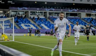 Real Madrid's Karim Benzema celebrates after scoring his side's second goal during the Champions League group B soccer match between Real Madrid and Borussia Monchengladbach at the Alfredo Di Stefano stadium in Madrid, Spain, Wednesday, Dec. 9, 2020. (AP Photo/Bernat Armangue)