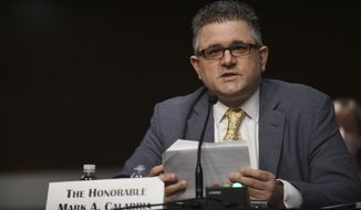 In this June 9, 2020, file photo, Federal Housing Finance Agency Director Mark Calabria testifies before a Senate Banking, Housing, and Urban Affairs Committee hearing on Capitol Hill in Washington. The Supreme Court is hearing a case on Dec. 9, 2020, that could make it easier for the president to fire the head of the agency that oversees government-controlled mortgage giants Fannie Mae and Freddie Mac. The case could also mean undoing an arrangement between the companies and the government that has sent $246 billion in their profits to the Treasury. That was compensation for the taxpayer bailout they received after the 2007 housing market crash. (Astrid Riecken/The Washington Post via AP, Pool)