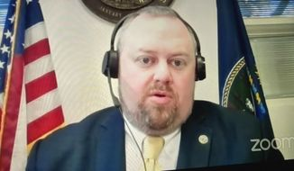 In this image from Tuesday, Dec. 8, 2020 video, Acting Labor Secretary Ryan Wright speaks via Zoom during a meeting of a Kansas Legislature committee in Topeka, Kan., overseeing the state's pandemic recovery efforts. Kansans are still reporting weeks of delay in getting unemployment benefits administered to what the department describes as an antiquated computer system. (Andy Tsubasa Field/Report for America via AP)