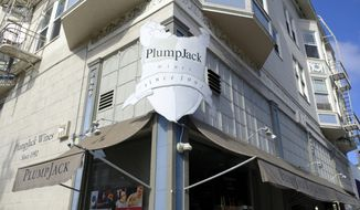 FILE - This Oct. 22, 2018, file photo shows the Plumpjack Wine & Spirits store in San Francisco, part of the Plumpjack Group collection of wineries, bars, restaurants, hotels and liquors stores. Companies affiliated with Gov. Gavin Newsom received nearly $3 million in loans designed to help small businesses survive the pandemic, more than eight times the amount originally reported, according to newly released information from the federal government. Nine businesses tied to Newsom's PlumpJack Group split the nearly $3 million in loans through the Small Business Administration's Paycheck Protection Program, according to new figures released last week. (AP Photo/Eric Risberg, File)