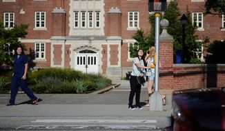 A national survey reports a 21.7% decline in college applications from high school seniors from one year ago. (Associated Press)