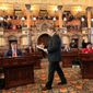 Electors set to gather on Monday to vote as part of the Electoral College, effectively appointing the next president. (Associated Press photographs)