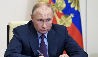 Russian President Vladimir Putin attends a meeting of the Council for Civil Society and Human Rights via a video conference at the Novo-Ogaryovo residence outside Moscow, Russia, Thursday, Dec. 10, 2020. (Alexei Nikolsky, Sputnik, Kremlin Pool Photo via AP)