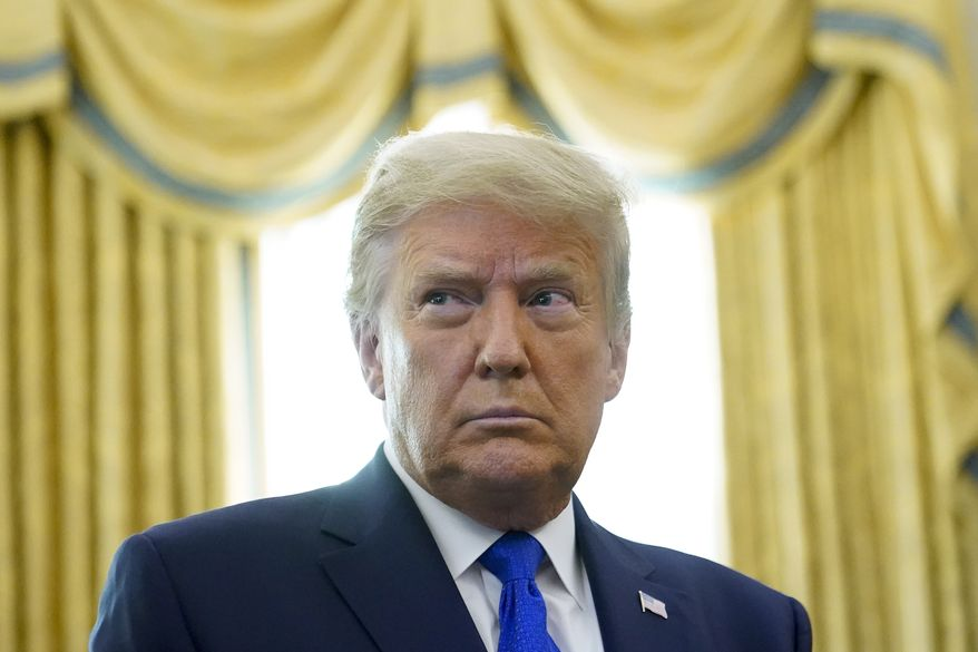 This Dec. 7, 2020, photo shows President Donald Trump in the Oval Office of the White House in Washington. Trump has announced that Israel and Morocco will normalize relations in the latest achievement of his administration's press to push Arab-Israeli peace.  (AP Photo/Patrick Semansky)