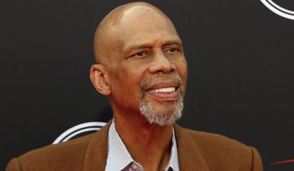 FILE - Kareem Abdul-Jabbar arrives at the ESPY Awards in Los Angeles, in this July 18, 2018, file photo. Abdul-Jabbar revealed he had prostate cancer in a magazine article he wrote about health risks faced by Blacks. Abdul-Jabbar, the NBA's career scoring leader, provided no other details about that illness in the piece he wrote for WebMD that first appeared Wednesday, Dec. 9, 2020. A publicist for Abdul-Jabbar said this is the first time he has spoken about the prostate cancer. (Photo by Willy Sanjuan/Invision/AP, File)