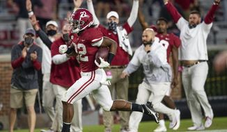 Alabama running back Najee Harris (22) scores a touchdown on a long run against Auburn during an NCAA college football game Saturday, Nov. 28, 2020, in Tuscaloosa, Ala. (Mickey Welsh/The Montgomery Advertiser via AP)