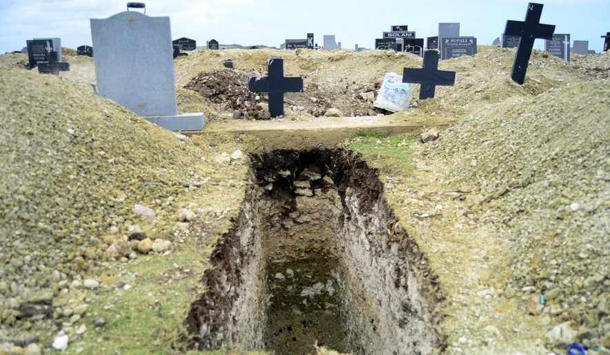 A freshly-dug grave sits at the Motherwell Cemetery in Port Elizabeth, South Africa, Friday, Dec. 4, 2020. Health Minister Zweli Mkhize announced on Wednesday, Dec. 9, 2020 that the country is now experiencing a Covid-19 pandemic second wave. (AP Photo/Theo Jeftha)