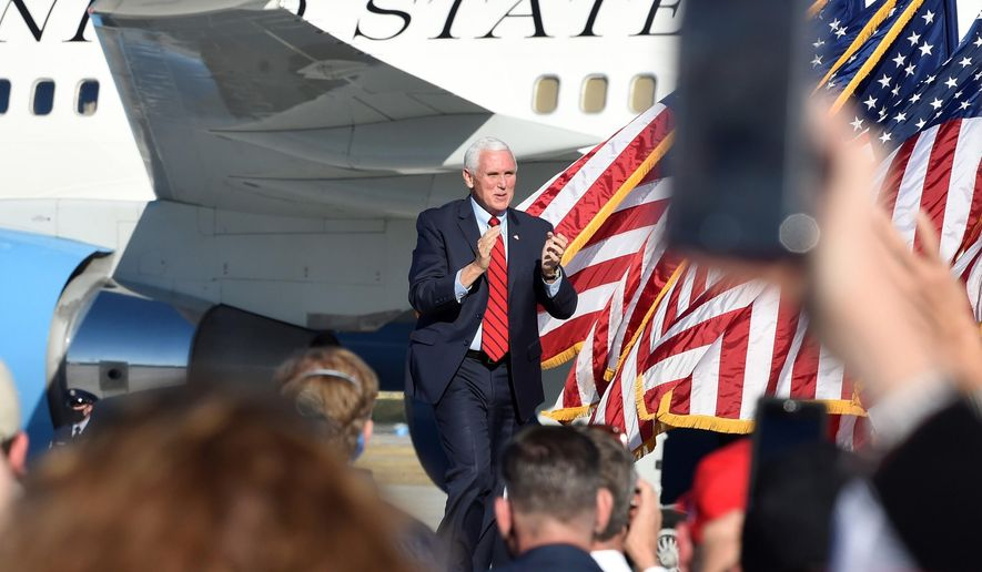 Vice President Mike Pence arrives at a Georgia Senate runoff campaign rally on Thursday, Dec. 10, 2020, in Augusta, Ga. (AP Photo/Meg Kinnard)