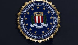 FILE - This Thursday, June 14, 2018, file photo, shows the FBI seal at a news conference at FBI headquarters in Washington. The FBI has been shaken by a series of sexual misconduct cases involving senior leadership over the past few years, including two new claims brought in December 2020 by women who say they were sexually assaulted by supervisors. (AP Photo/Jose Luis Magana, File)
