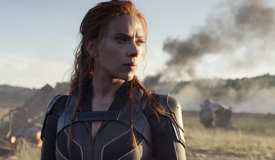 "This image released by Disney/Marvel Studios' shows Scarlett Johansson in a scene from ""Black Widow.""  (Marvel Studios/Disney via AP)"