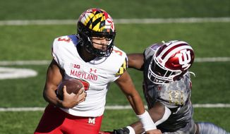 Maryland quarterback Taulia Tagovailoa (3) runs past Indiana's D.K. Bonhomme (42) during the first half of an NCAA college football game, Saturday, Nov. 28, 2020, in Bloomington, Ind. (AP Photo/Darron Cummings) **FILE**