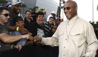 """FILE - In this Monday, Aug. 10, 2015 file photo, Tommy 'Tiny' Lister greets fans as he arrives at the Los Angeles premiere of """"Straight Outta Compton"""" at the Microsoft Theater. Tommy """"Tiny"""" Lister, a former wrestler who was known for his Deebo character in the """"Friday"""" films, has died. He was 62. Lister manager, Cindy Cowan, said Lister was found unconscious in his home in Marina Del Rey, California, on Thursday, Dec. 10, 2020. He was pronounced dead at the scene.  (Photo by John Salangsang/Invision/AP, File)"""