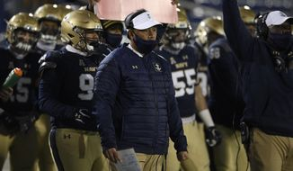 Navy head coach Ken Niumatalolo watches from the sidelines during the first half of an NCAA college football game against Tulsa, Saturday, Dec. 5, 2020, in Annapolis, Md. (AP Photo/Nick Wass)  **FILE **