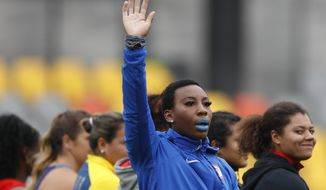 In this Aug. 10, 2019, file photo, Gwen Berry of the United States waves as she is introduced at the start of the women's hammer throw final during athletics competition at the Pan American Games in Lima, Peru. In the summer of 2019, U.S Olympic and Paralympic Committee CEO Sarah Hirshland reprimanded Berry and fencer Race Imboden for violating Rule 50, which prohibits inside-the-lines protests at the games, after Berry raised her fist and Imboden kneeled on the medals stand at the Pan-Am Games in Peru. (AP Photo/Rebecca Blackwell, File)  **FILE**