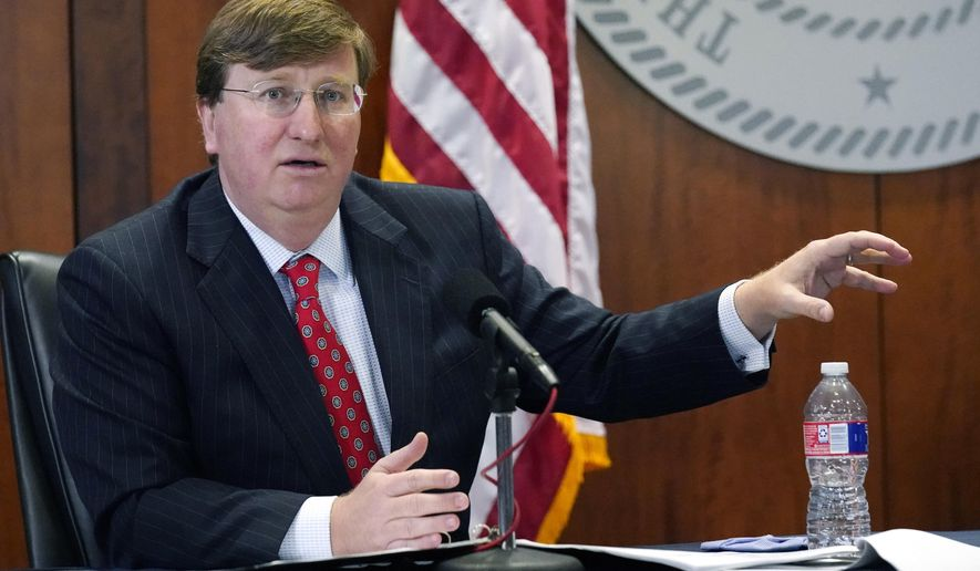 Mississippi Gov. Tate Reeves responds to questions regarding the holiday social receptions his office planned at the Governor's Mansion, during his covid news briefing, Wednesday, Dec. 9, 2020 in Jackson, Miss. (AP Photo/Rogelio V. Solis)