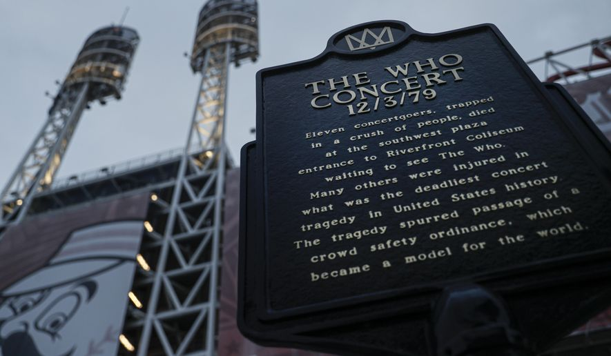FILE - This Wednesday, Nov. 20, 2019, file photo shows a memorial plaque for the 11 concertgoers who were killed in a crush of people entering a 1979 concert by the British rock band The Who, outside Great American Ball Park in Cincinnati. Alumni of nearby Finneytown High School, who lost three classmates in the tragedy, faced obstacles in 2020 to their annual memorial scholarship fund-raising event. In the end, they created a show of prerecorded video interviews with The Who's frontman, Roger Daltrey, guitarist-songwriter Pete Townshend and a mix of recorded and live discussions with relatives of the 11 people killed in the tragedy. (AP Photo/John Minchillo, File)