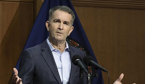 Virginia Gov. Ralph Northam addresses the public and the media while giving new restriction orders for Virginians dealing with the coronavirus during a press conference at the Patrick Henry Building in Richmond, Va., Thursday, Dec. 10, 2020. (Bob Brown/Richmond Times-Dispatch via AP) ** FILE **