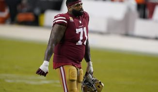 FILE - San Francisco 49ers offensive tackle Trent Williams (71) walks off the field after the 49ers were defeated by the Philadelphia Eagles in an NFL football game in Santa Clara, Calif., in this Sunday, Oct. 4, 2020, file photo. All the bitterness and anger that characterized Trent Williams' final year in Washington when he sat out the 2019 season, feuded with management and ultimately forced a trade to San Francisco are in the past. Williams is headed into his first game against his former team on Sunday when the 49ers take on Washington, saying he holds no ill will to his former franchise. (AP Photo/Tony Avelar, File)