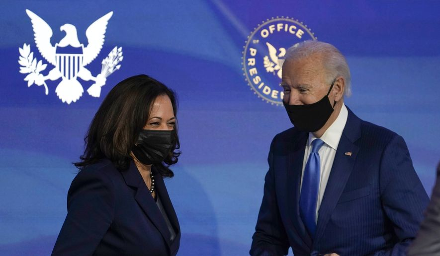President-elect Joe Biden, right, and Vice President-elect Kamala Harris, left, share a laugh during an event to announce several choices for positions in the Biden administration at The Queen theater in Wilmington, Del., Friday, Dec. 11, 2020. (AP Photo/Susan Walsh) ** FILE **