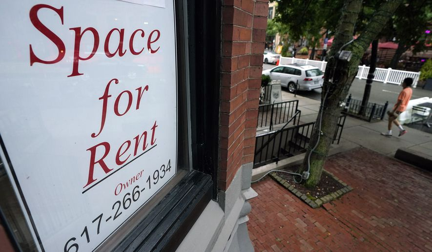 A passer-by walks past a business storefront with a space for rent sign in a window, Wednesday, Sept. 2, 2020, in Boston. U.S. companies added jobs at a modest pace last month, a private survey found, a sign that while hiring continues, it is only soaking up a relatively small proportion of the unemployed. (AP Photo/Steven Senne)