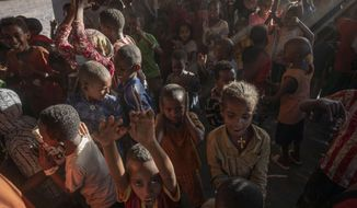 Tigray refugee children sing and dance inside a tent run by UNICEF for children's activities, in Umm Rakouba refugee camp in Qadarif, eastern Sudan, Thursday, Dec. 10, 2020. (AP Photo/Nariman El-Mofty)