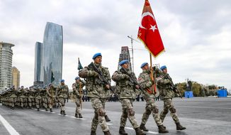 Members of a Turkish forces commando brigade take part in a military parade in which Turkey's President Recep Tayyip Erdogan and Azerbaijan's President Ilham Aliyev, looked on in Baku, Azerbaijan, Thursday, Dec. 10, 2020. The massive parade was held in celebration of the peace deal with Armenia over Nagorno-Karabakh that saw Azerbaijan reclaim much of the separatist region along with surrounding areas. (AP Photo)