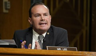 FILE - In this Nov. 10, 2020, file photo, Sen. Mike Lee, R-Utah, speaks during a Senate Judiciary Committee hearing on Capitol Hill in Washington. Lee objected Thursday, Dec. 10, to the creation of the two proposed Smithsonian museums to honor American Latinos and women, stalling two projects that have been in the making for decades and enjoy broad bipartisan support. (AP Photo/Susan Walsh, Pool, File)