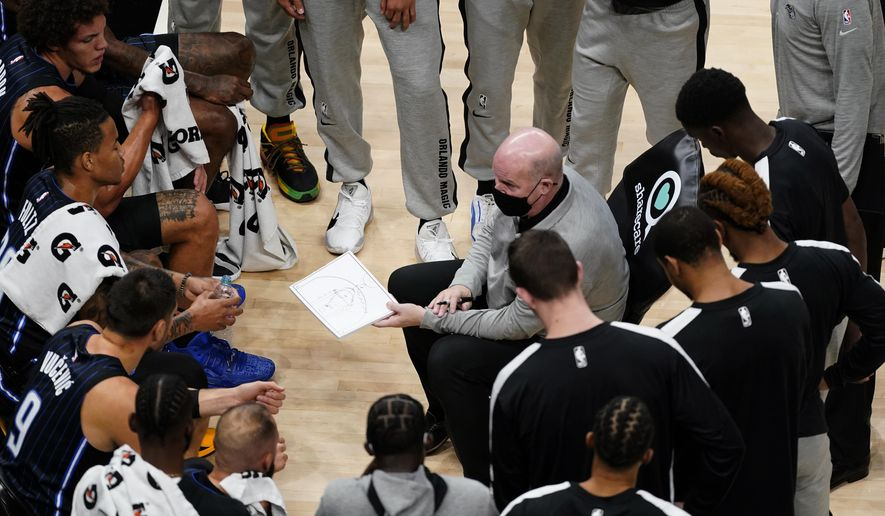 Orlando Magic coach Steve Clifford talks to players during a timeout in the first half of the team's NBA preseason basketball game against the Atlanta Hawks on Friday, Dec. 11, 2020, in Atlanta. (AP Photo/John Bazemore)