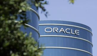 FILE - This June 26, 2007 file photo shows the exterior of Oracle Corp. headquarters in Redwood City, Calif. Tech giant Oracle Corp. said Friday, Dec. 11, 2020 it will move its headquarters from Silicon Valley to Austin, Texas, and let many employees choose their office locations and decide whether to work from home. (AP Photo/Paul Sakuma, File)