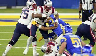 New England Patriots quarterback Cam Newton, center, is sacked by Los Angeles Rams linebacker Kenny Young during the second half of an NFL football game Thursday, Dec. 10, 2020, in Inglewood, Calif. (AP Photo/Ashley Landis)